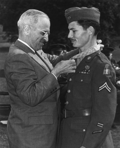 Desmond, Sr. receiving the Congressional Medal of Honor from President Truman.
